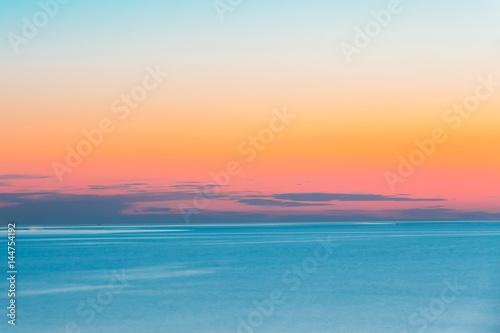 Foto op Plexiglas Zee / Oceaan Calm Sea Or Ocean And Colorful Sunset Or Sunrise Sky Background.