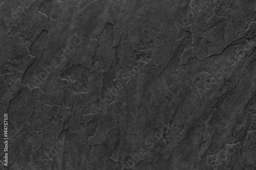 Dark grey slate background or texture.