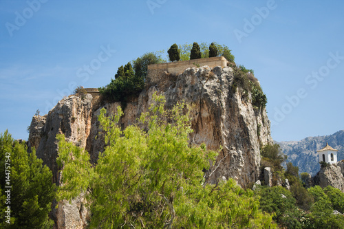 Photo  El Castell de Guadalest or briefly Guadalest is a Valencian town and municipalit