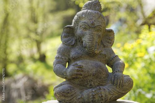 Ganesh Stone Statue In A Garden