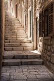 Fototapeta  - Light pours down a steep narrow Dubrovnik alleyway, Croatia