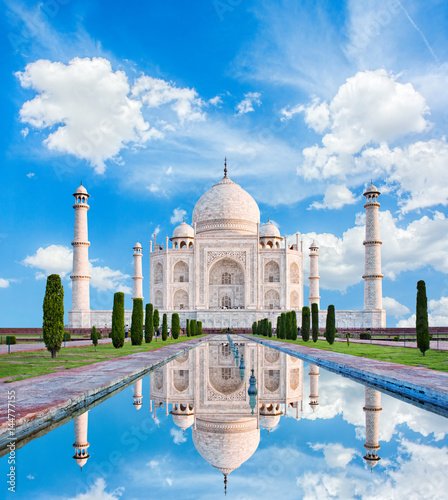 Fotografie, Obraz  Amazing view on the Taj Mahal in sun light with reflection in water