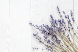 Fototapeta Lavender - lavender desk design with flowers on white background top view mock up