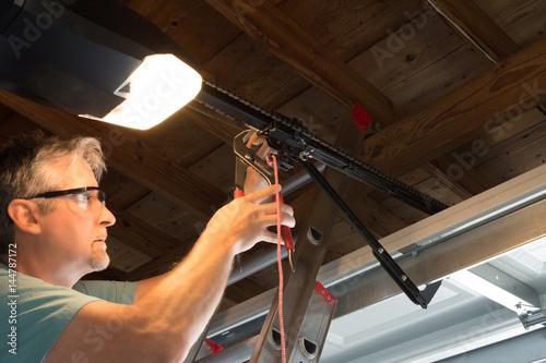 Closeup Of A Professional Automatic Garage Door Opener Repair