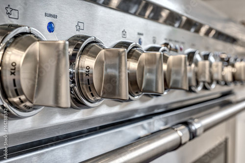 close up of knobs on quality gas stove
