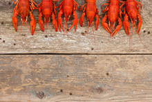 Crawfish On The Old Wooden Background.