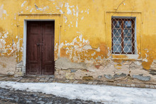 Very Old Door And Window In A Wall With Peeling Plaster