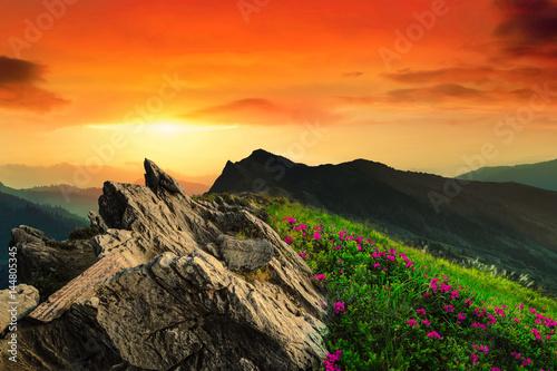 Spoed Fotobehang Oranje eclat Mountain peak landscape.