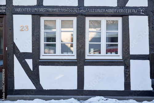 Two White Colonial Style Windows In A And Black Painted Timbered House Winterberg