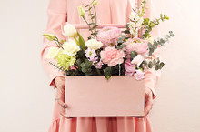 Pink Wooden Box With Flowers Roses And Carnations In Girl's Hands