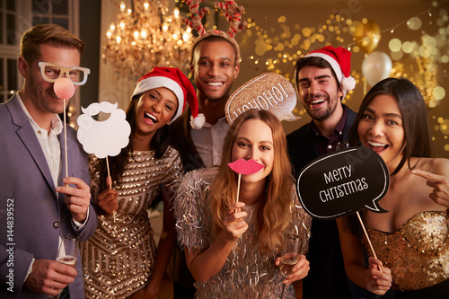 Spoed Fotobehang Kerstmis Group Of Friends Dressing Up For Christmas Party Together