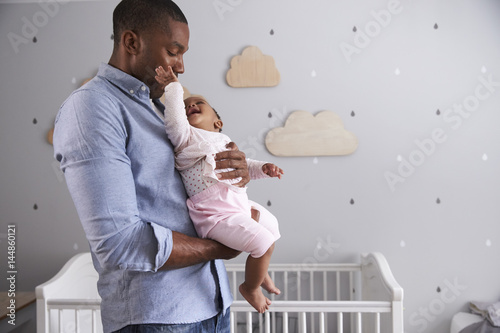 Photo  Father Holding Baby Daughter In Nursery