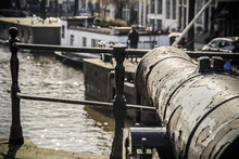 Old Cannon At Prinsengracht Canal In Amsterdam, Netherlands