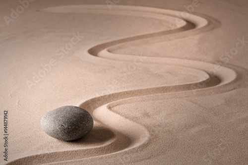 Foto op Plexiglas Stenen in het Zand Spirituality and harmony through zen meditation stone for focus on purity and relaxation. ..