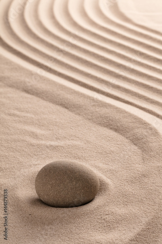 Photo sur Plexiglas Zen pierres a sable zen meditation stone background to a buddhism ying yang for relaxation balance and harmony spirituality or spa wellness concept for purity serenity jing jang