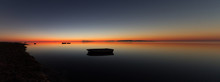 A Warm Sunset On A Calm Water,...
