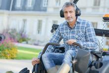 Man Driving Mower