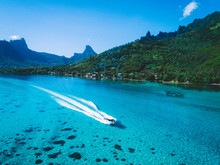 Speedboat On Sea By Green Mountains, Mo'orea, South Pacific