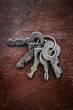 Bunch of old keys on a wooden surface
