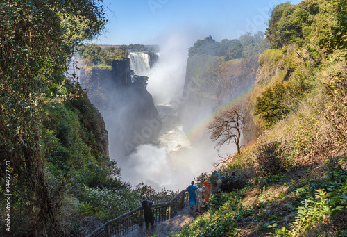 Staande foto Afrika The Victoria falls is the largest curtain of water in the world (1708 meters wide). The falls and the surrounding area is the National Parks and World Heritage Site - Zambia, Zimbabwe.