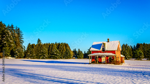 e8a94ac850fca ... Canada under clear blue sky. By hpbfotos. Red dilapidated and abandoned  house in a wide snow covered field in Glen Valley in the
