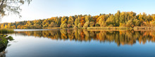 Panoramic View On Lake With Forest Reflecting In Calm Water In Indian Summer. Moscow, Russia.