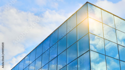 mata magnetyczna Blue sky with white clouds reflected in the windows. Abstract background for business purposes.