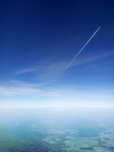 A Passenger Plane Flying In The Blue Sky, View From Another Plane Flying