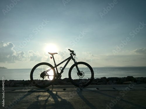 Spoed Foto op Canvas Noordzee Cycling for exercise To visit beautiful seashore