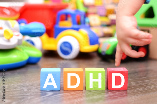 Photo Attention Deficit Hyperactivity Disorder or ADHD concept with toddler hand touch