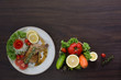 Grilled Chicken steak with black pepper In white dish and vegetables in the basket On the wooden table