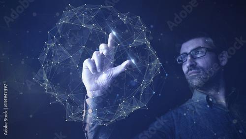 Fotografering  man touching digital network