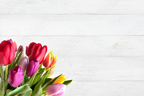 Foto op Plexiglas Tulp Colorful tulips on white wood