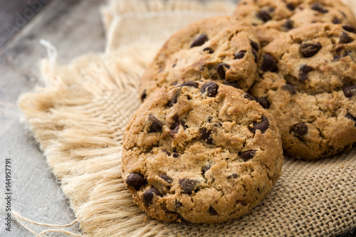 Tuinposter Koekjes Close up chocolate chip cookies on wooden table background