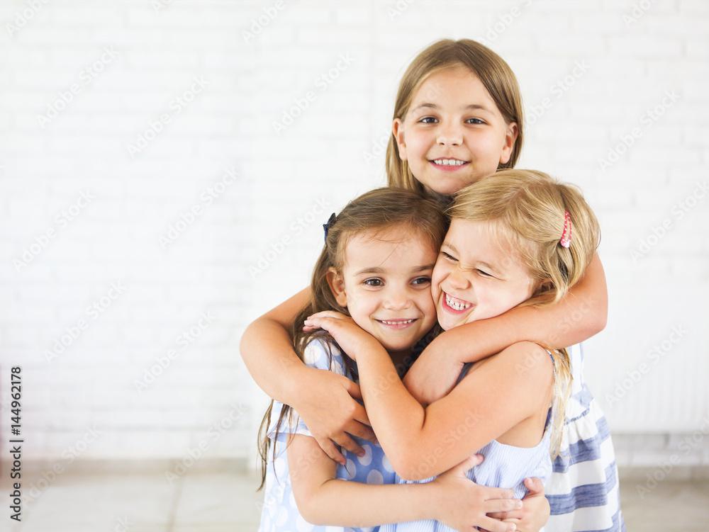 Fototapety, obrazy: Happy funny girls embrace together