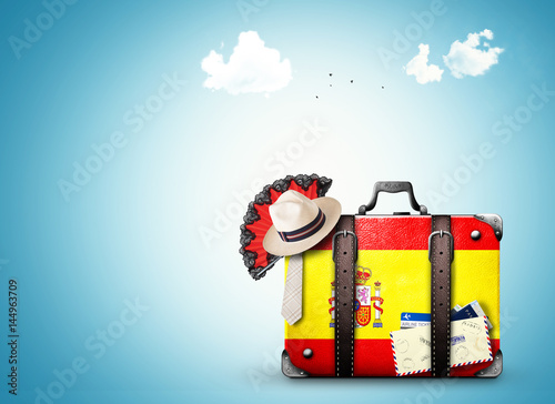 Spain, vintage suitcase with Spanish flag Canvas Print