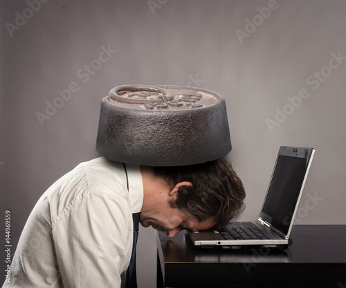 Photo businessman with a weight over his head. stress concept