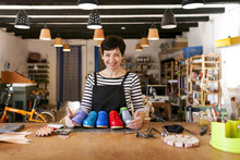 Portrait Of Confident Shoemaker In Her Workshop