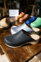 Assortment Of Clogs On Table