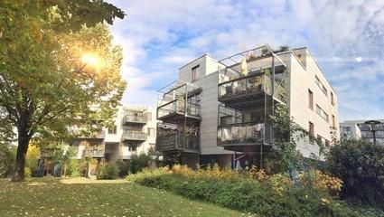 Fototapeta Modern residential buildings in urban settlement