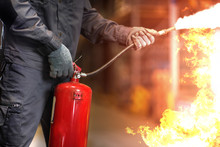Man Using Fire Extinguisher Fi...