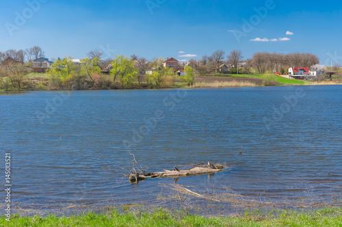 Fotografering  Pictorial spring landscape with Suha Sura river in Vasylivka village near Dnepr