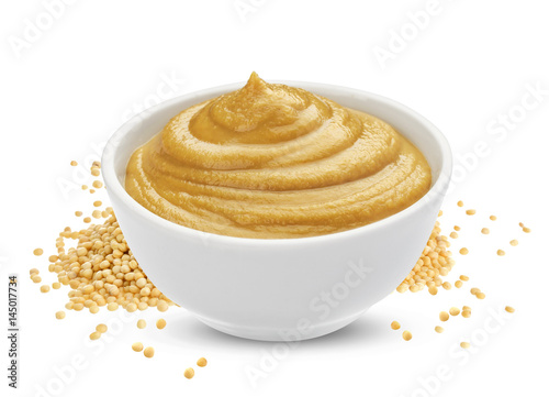 Photo  Mustard sauce in bowl and mustard seeds isolated on white background