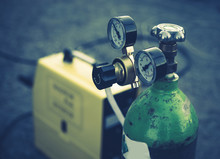 Welding Equipment. Acetylene Gas Cylinder Tank With Gauge Regulators Manometers.