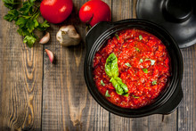 Basic Italian Tomato Sauce Marinara For Pasta. In A Saucepot Pan With Ingredients On A Wooden Table. Top View Copy Space