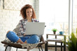 canvas print picture - Beautiful young woman using laptop at home