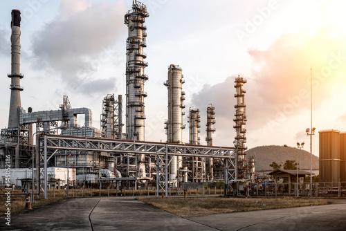 Fototapeta Oil Industry Refinery factory at Sunset, Petroleum, petrochemical plant obraz