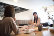 Women are meeting in a stylish conference room