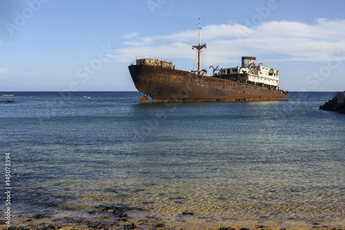 Tuinposter Schipbreuk Rusted ship in crystal clear sea, Arrecife, Lanzarote, Canary Islands, Spain