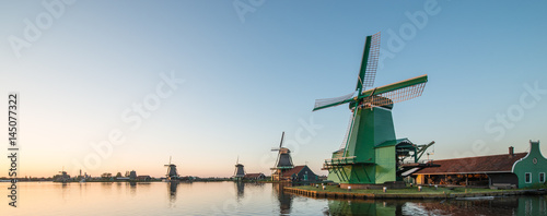 Traditional Dutch windmills with canal close